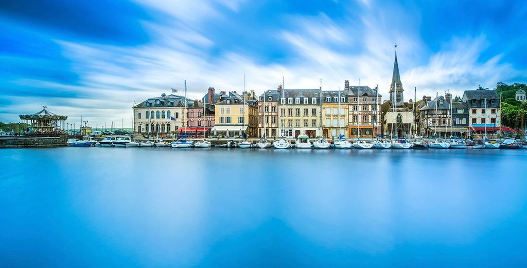 Your first stop is in the pretty medieval town of Honfleur, where eateries dot the harbour