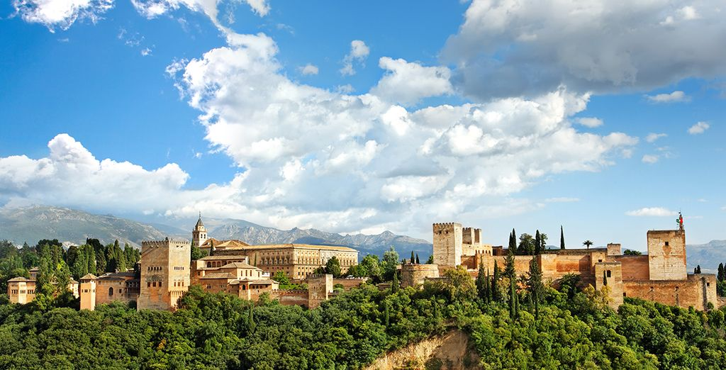 Make sure you visit the city's jewel, the Alhambra, standing proud
