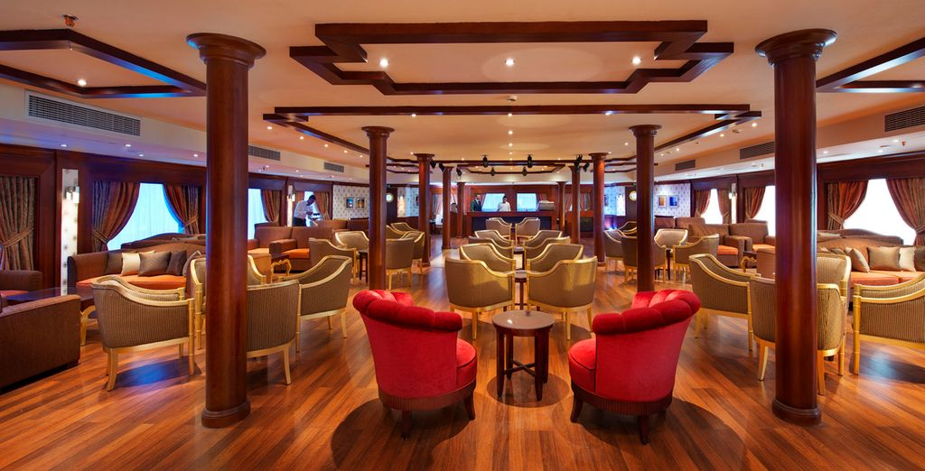 Chill out in the plushly decorated lounge onboard